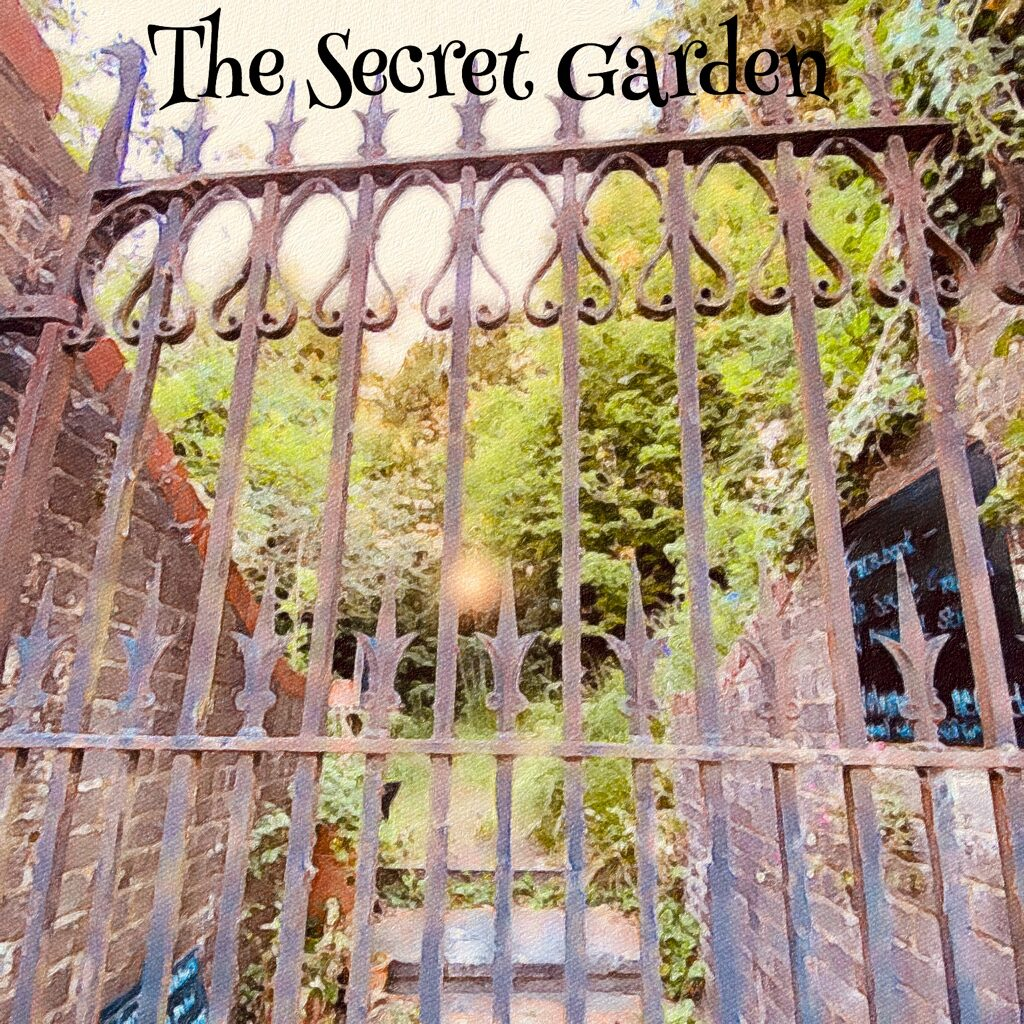 photo looking through the gate of the Secret Garden from Mill Rd