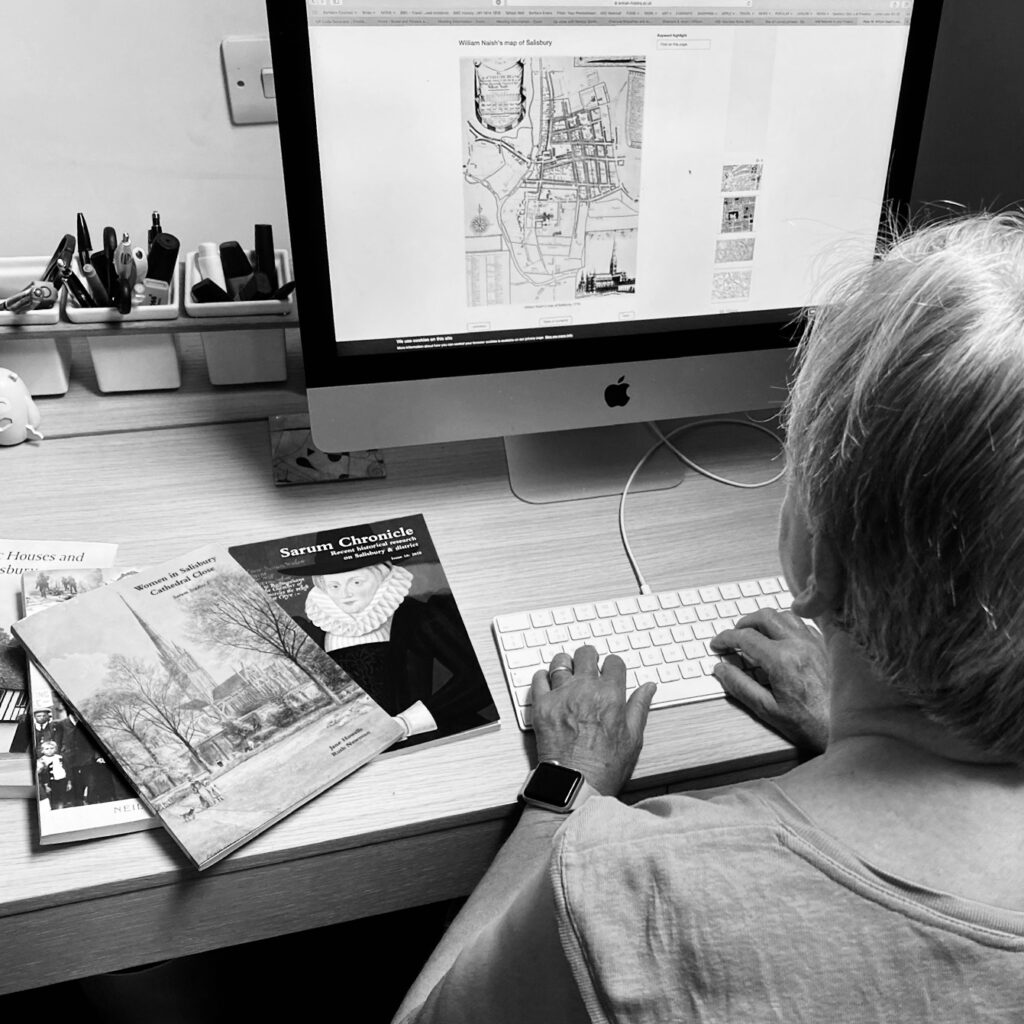 person at computer doing historic research