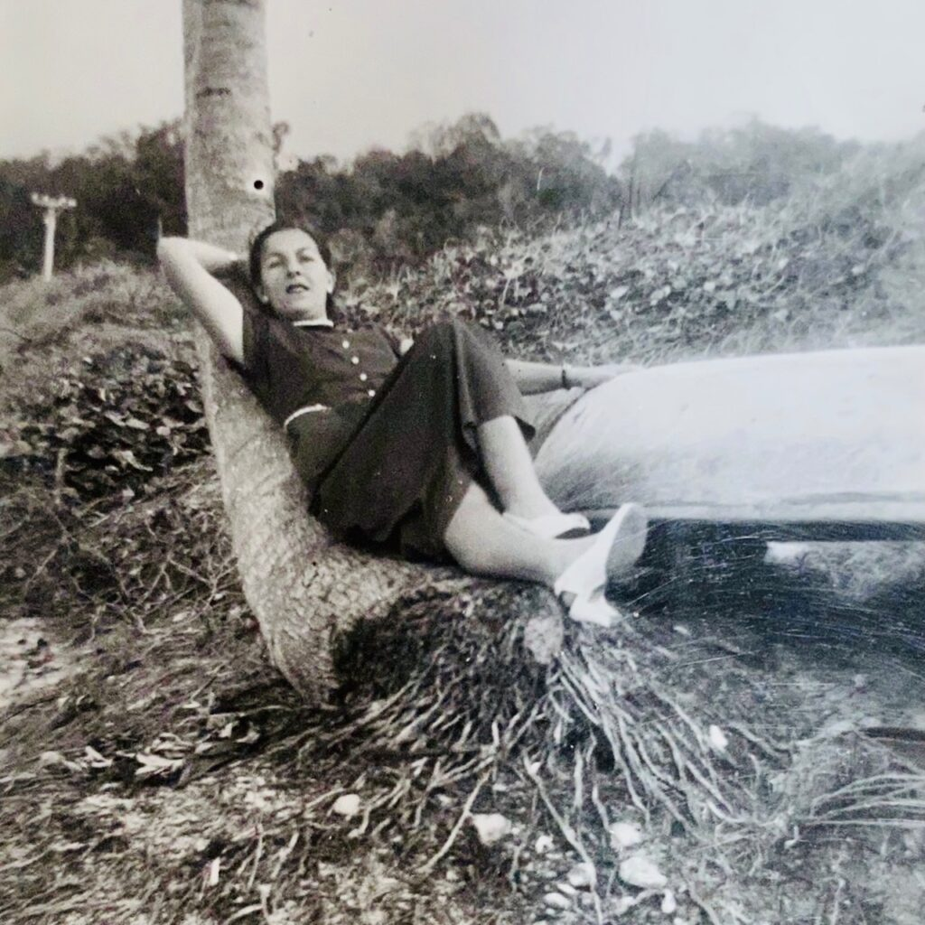 PhyllisReclining on a coconut trunk with my hand on a fishing canoe probably a dug-out cotton tree