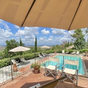 swimming pool at Volterra with umbrellas and chairs