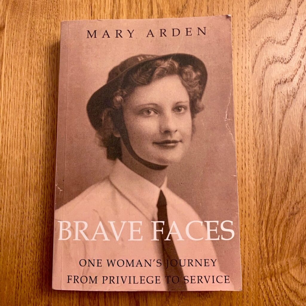 Front cover of the paperback copy of Eve's book Brave Faces showing a photo of her during WW2 war
