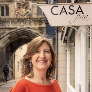 Susi outside Casa Fina in Salisbury High St cathedral gate in the background
