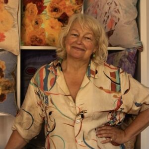 Georgina von Etzdorf in her shop in Wilton with some of her colourful cushions