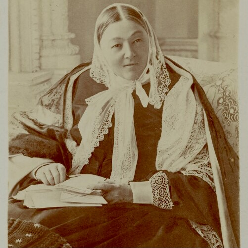 Florence as an older woman - seated