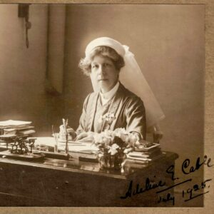 Adeline Cable in uniform at her desk in 1925