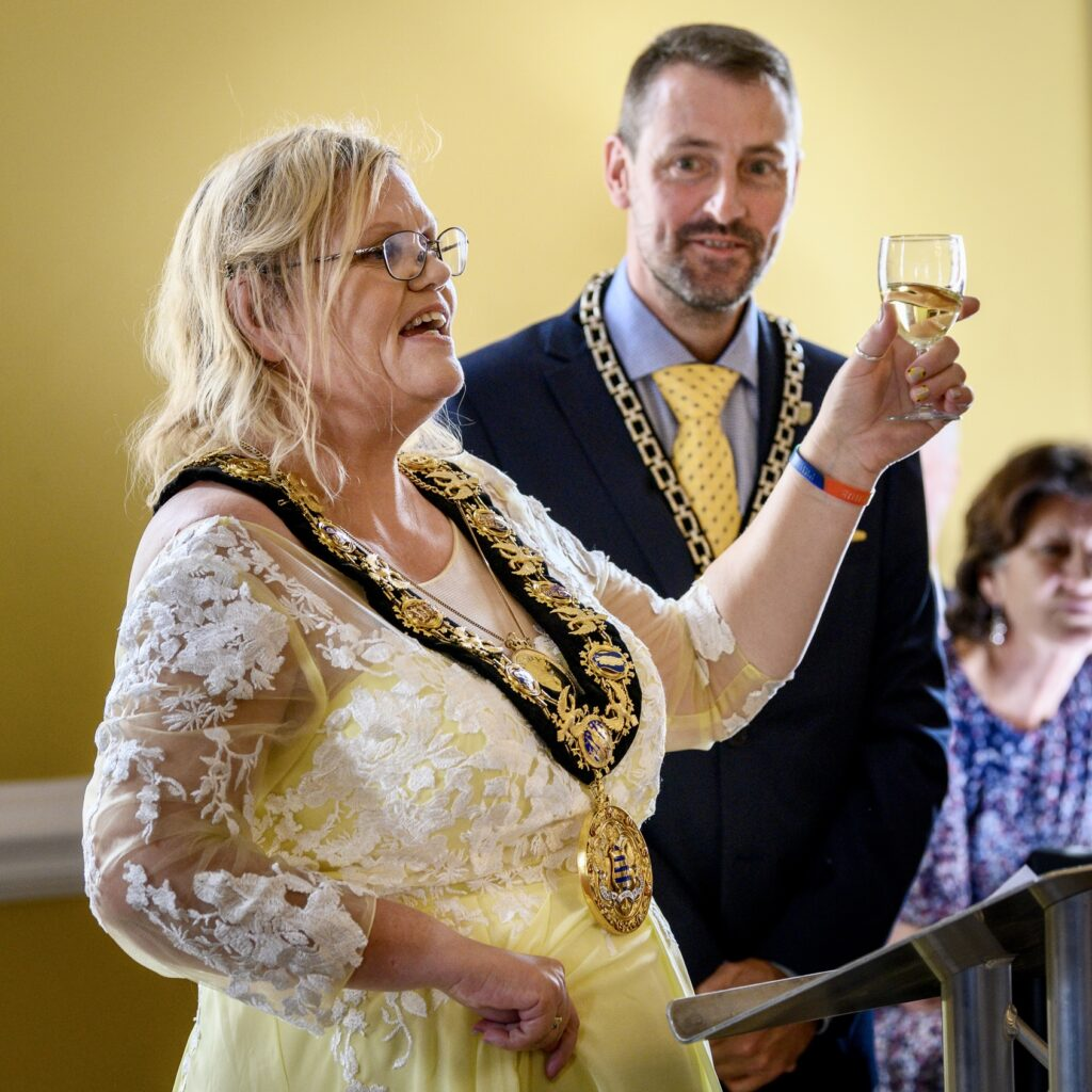 Raising a glass with husband Tom at a mayoral reception