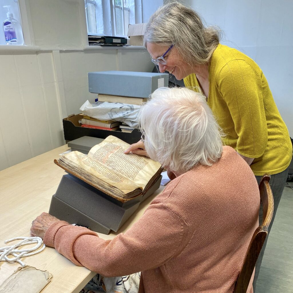 Emily working with a volunteer in the archive